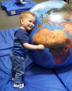 child with globe 1