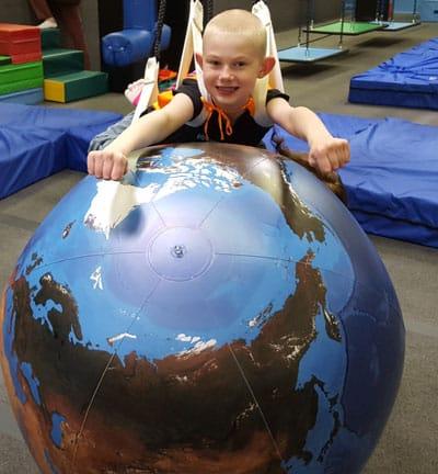 child with globe 2